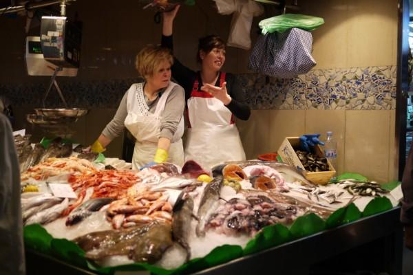 Fish vendors at  La Boqueria Mercat in Barcelona