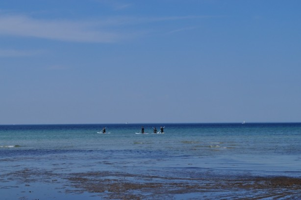 Heading out to paddle board in the Baltic Sea