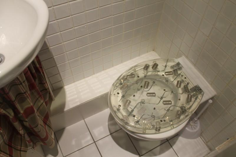 A razor blade toilet at Hotel Pelirocco