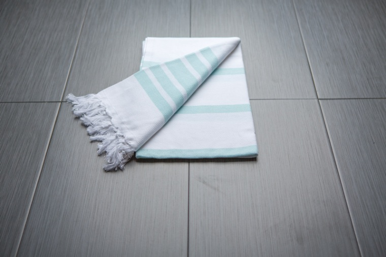 The Gift Guide for Travelers featuring only sustainable gifts and gifts which give back to local communities. Pictured: Findikli Design's Turkish Towel, which benefits local workers. For more, visit www.dtravelsround.com